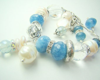 Pearl, blue stone, silver, crystal charm bracelet... QUIET WATERS