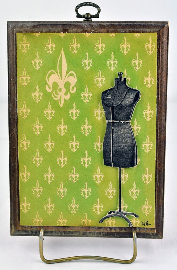 WALL PLAQUE covered in old paper with 3-d vintage dress form
