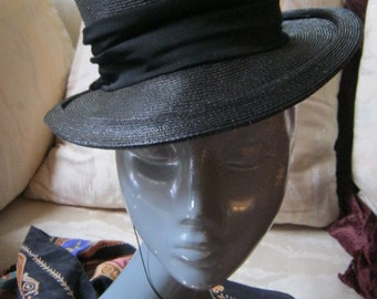 Vintage smaller ightly woven black fiber hat, black woven  womans topper hat, black mini hat with wide ribbon band