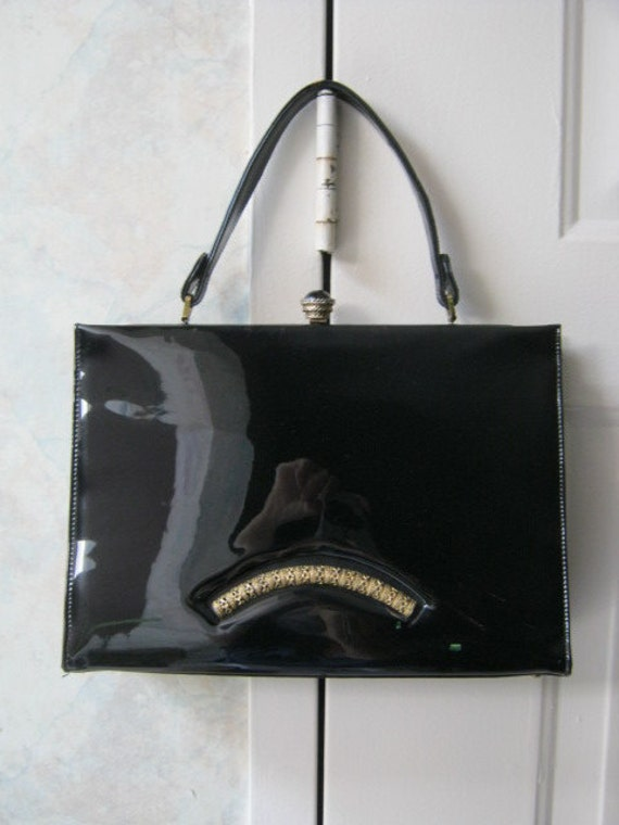 Large black patent Kelly Girl handbag with ornate buckle and front design by Viki Originals