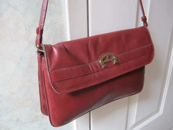 Dark burgundy leather double pouch shoulder bag by Etienne Aigner