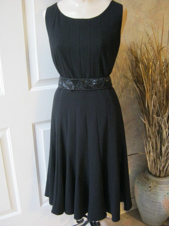 Perfect black fit and flair sleeveless cocktail dress by Calvin Klein size 12