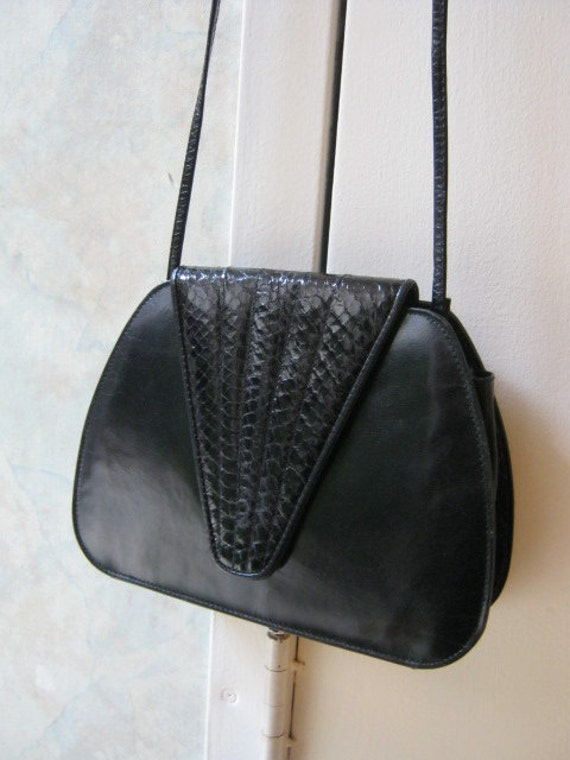 Small black all leather special occasion bag with snakeskin detail by Lissette