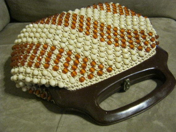 Cognac and cream faceted bead clutch with lucite handle by Donna