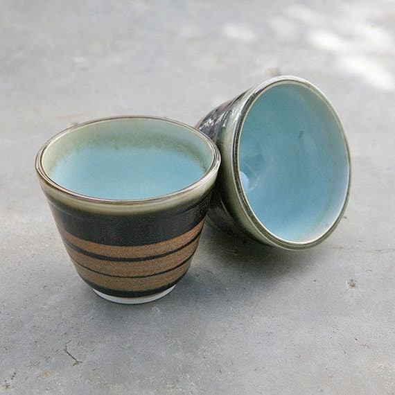 Pair of Wheel Thrown Porcelain tea cups with blue interiors
