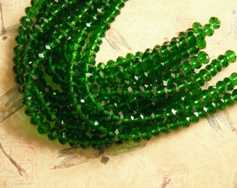Green Crystal Faceted Designer Glass Beads, 2 - 8 Inch Strands 8x5mm.