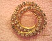 Vintage Brooch 2 layered rings of rhinestones on a gold tone metal frame SALE