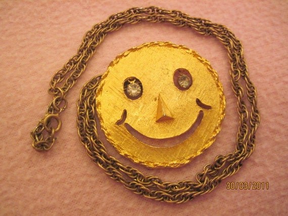 Vintage Gold Tone Metal Smiley Face Necklace with Rhinestone eyes can also be a brooch SALE