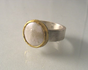 Charisma Ring - pearl set in 22k yellow  gold on matte silver band. Cocktail ring.