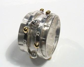 Vertigo-silver and  solid gold spinners on silver band,Spinning two tone ring.