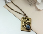 Two Hearts that Beat as One... - An Antiqued Gold Interlocking Hearts Pendant Necklace