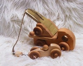 Natural wooden crane truck with race car