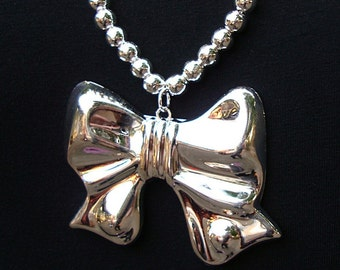 Vintage Silver tone metal Bow Necklace