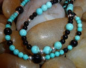 Two necklaces of turquoise, obsidian, onyx and sterling silver