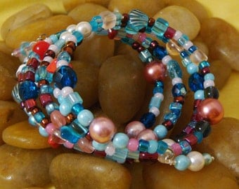 Bracelet, memory wire, glass and seed beads, regular