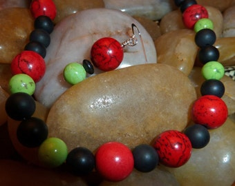Necklace and earrings of red and lime turquoise and black onyx