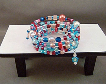 Bracelet, aqua red pink, glass and seed beads, regular, memory wire