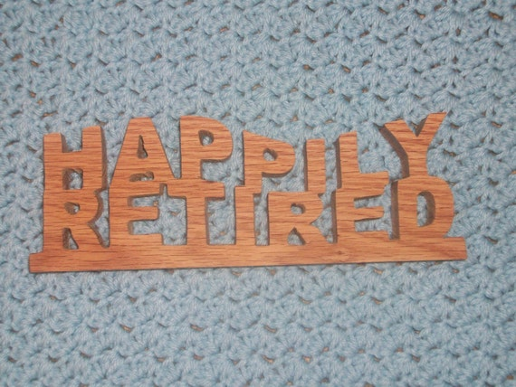 Happily retired wood sign
