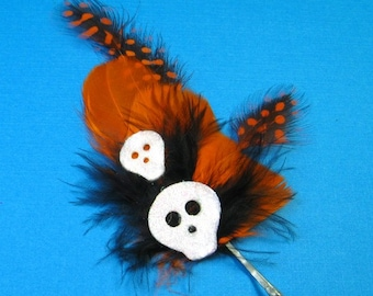 Halloween Feather Fascinator - glittery skulls with black and orange feathers