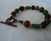 RESERVED FOR ORALIA-  Green and Brown Copper Bracelet
