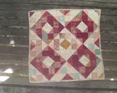 Quilted Table Topper in burgundy, pink, green, cream