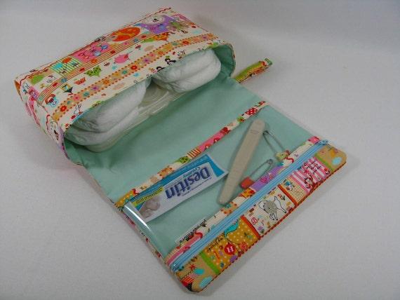 Diaper Clutch with clear zipper pouch-- Cosmo Textile Border Strips Amusement Park