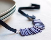 Necklace violet coconut beads and navy blue Ribbon