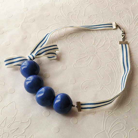 Necklace Blue resin beads and bow