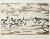 original etching of bicycles by the sea