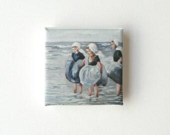girls paddling in the sea mini canvas print