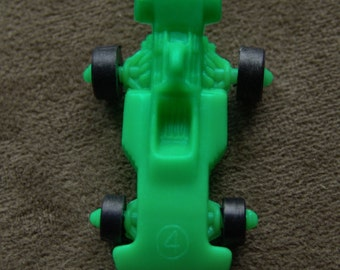 1970s Plastic RACE CAR with Action Wheels