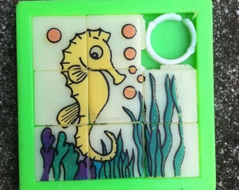1960s-70s Plastic Two Inch Slider Puzzle SEA HORSE