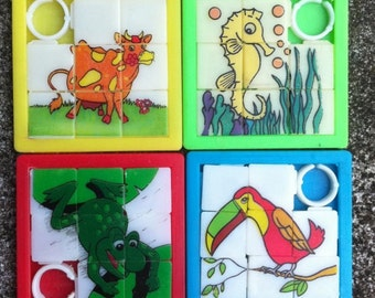 SET OF FOUR 1960s-70s Plastic Two Inch Slider Puzzles