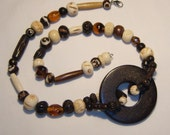 Wood, bone, glass bead pendant necklace, unusual design, dark browns, browns, ivory