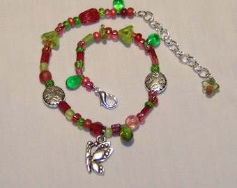 ANKLET, butterfly charm, beautiful combination of reds, greens, pinks, silver metal beads with flowers on them