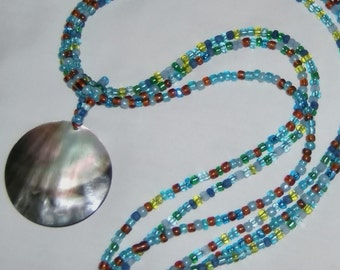 Triple strand beaded mother of pearl pendant, necklace, blue, green and brown