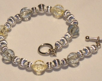 Pretty light yellow and light green BRACELET with fluted silver color beads, great for spring, summer or fall