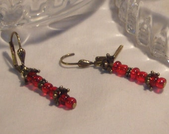 Beautiful elegant earrings beaded with deep red and antiqued brass beads that dangle just the right length