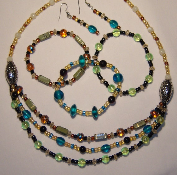 No desription would do jewelry set, necklace, three bracelets, dangle earrings, teals, brwons, greens, golden, tans, ivory, black