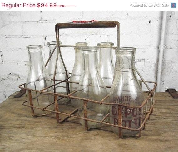 sale antique metal milk bottle carrier with six bottles. Black Bedroom Furniture Sets. Home Design Ideas