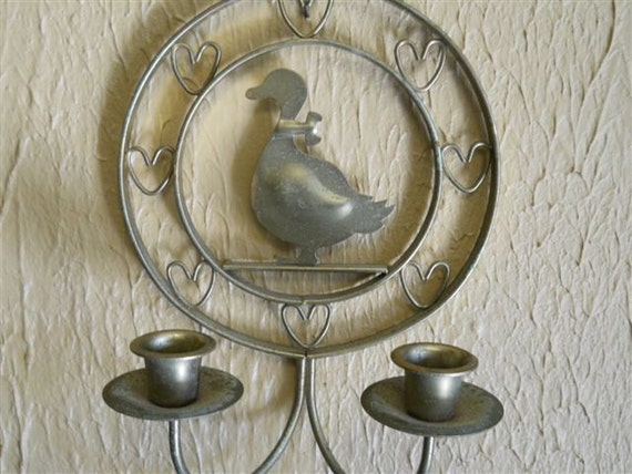 Pair of vintage brass colored metal wall hanging duck candle holders