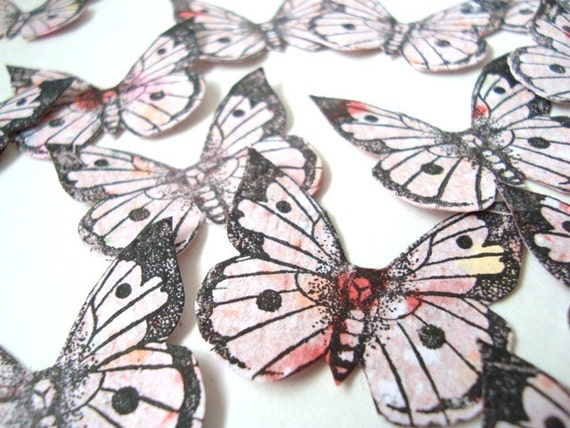 Hand stamped, hand cut paper butterflies. Pale pink/red.  x 30 ( number 20)