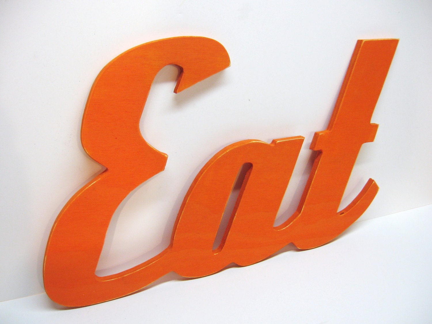 wood eat sign painted orange distressed retro wood wall