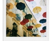 Polaroid of umbrellas as rain in a 4x5 inches fine art print, hand signed by its author