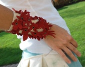 Red flowers on white leather cuff