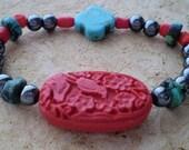 Hematite /Turquoise Bracelet Cinnabar/Howlite Focals