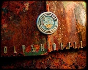 Miss Jasmine's Emblem - Rusty Car - Fine Art Photography