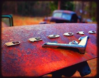 Desmond's Rear Emblem - Rusty Car - Car Emblem - Chrysler Desoto - Fine Art Photograph by Kelly Warren