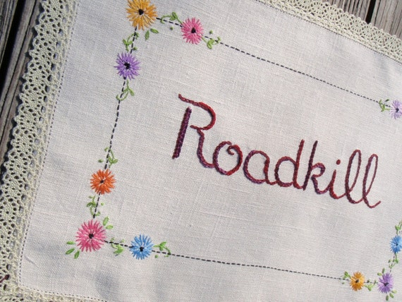 Roadkill art embroidery on upcycled vintage linen