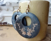 blue wooden disc earrings with etched flower